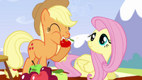 Applejack biting apple S3E7